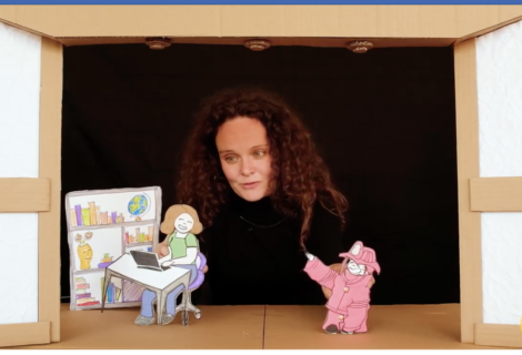 A cardboard puppet theater